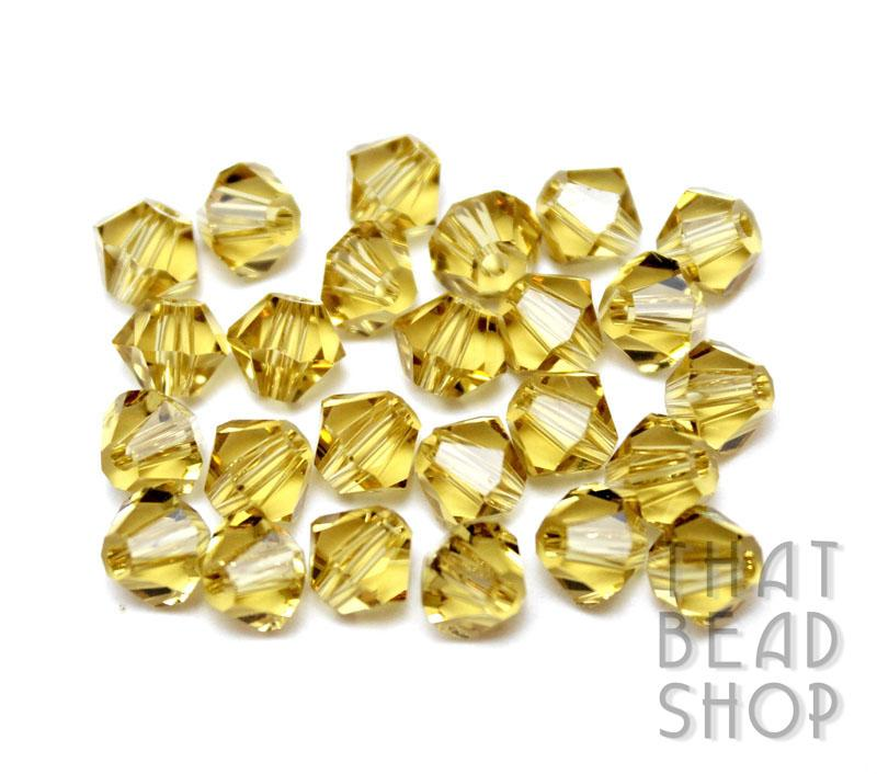 6mm Light Gold Crystal Bicone